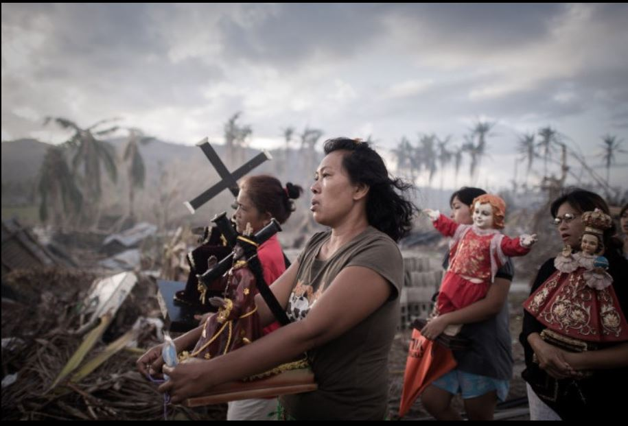 Local residents lit fires to burn the debris left by the typhoon Haiyan  Tolosa Leyte, The Philippines. Nov. 18  2013