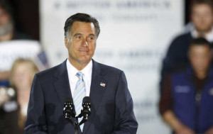 Republican presidential candidate former Massachusetts Governor Mitt Romney speaks at a primary night rally in Manchester