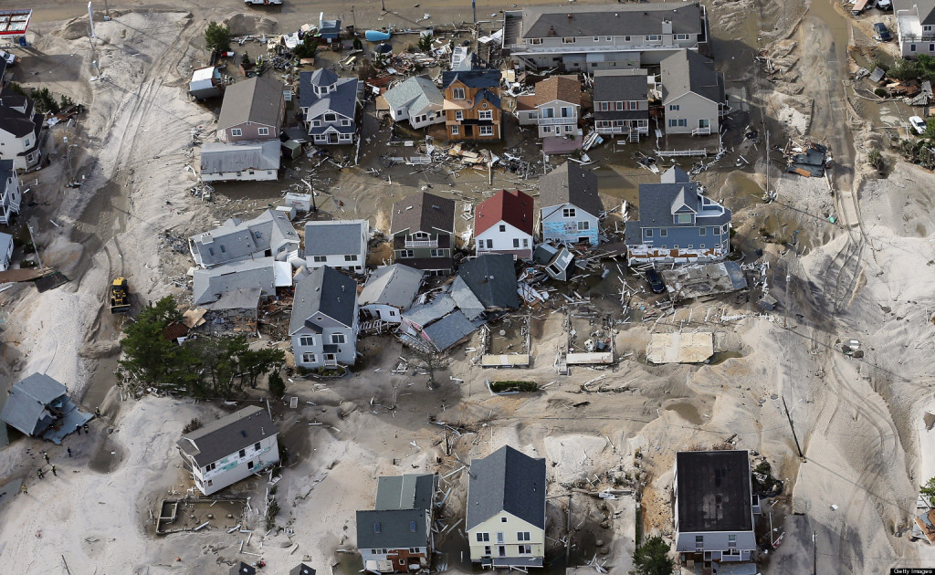 SEASIDE HEIGHTS, NJ - OCTOBER 31: Homes wrecked by Superstorm Sandy sit amongst sand washed ashore on October 31, 2012 in Seaside Heights, New Jersey. At least 50 people were reportedly killed in the U.S. by Sandy with New Jersey suffering massive damage and power outages.  (Photo by Mario Tama/Getty Images)