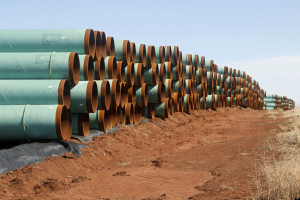 FILE - In this Wednesday, Feb. 1, 2012 file photo, miles of pipe ready to become part of the Keystone Pipeline are stacked in a field near Ripley, Okla. The controversy over the pipeline in the hub of Oklahoma's oil activity, was voted the number nine story of the state for 2012. (AP Photo/Sue Ogrocki, File)