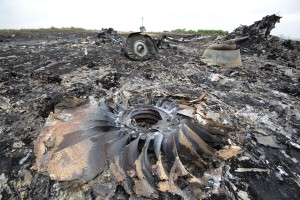 A picture taken on July 18, 2014 shows the wreckages of the Malaysia Airlines jet carrying 298 people from Amsterdam to Kuala Lumpur a day after it crashed, near the town of Shaktarsk, in rebel-held east Ukraine. Pro-Russian rebels fighting central Kiev authorities claimed on July 17 that the Malaysian airline that crashed in Ukraine had been shot down by a Ukrainian jet. The head of Ukraine's air traffic control agency said Thursday that the crew of the Malaysia Airlines jet that crashed in the separatist east had reported no problems during flight. All 298 people on board Flight MH17 died when the plane crashed. AFP PHOTO/DOMINIQUE FAGETDOMINIQUE FAGET/AFP/Getty Images