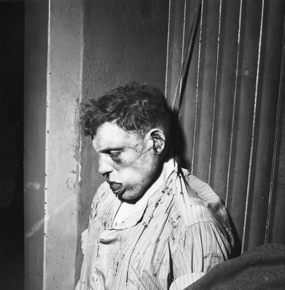 Unknown Buchenwald guard, beaten and hanged n by the American military photographer Elizabeth Miller.