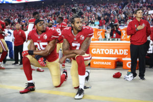 Eric Reid and Colin Kapernick kneeling during the National Anthem.